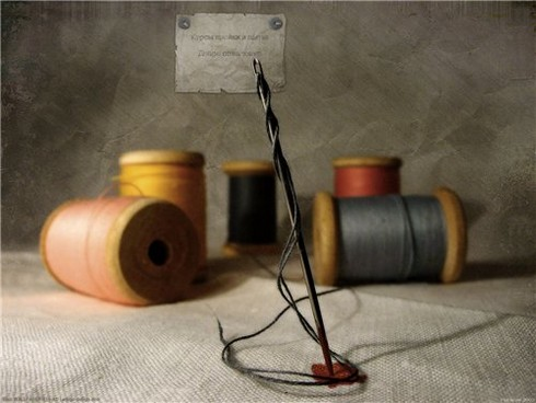 Швейная игла с нитками фото
