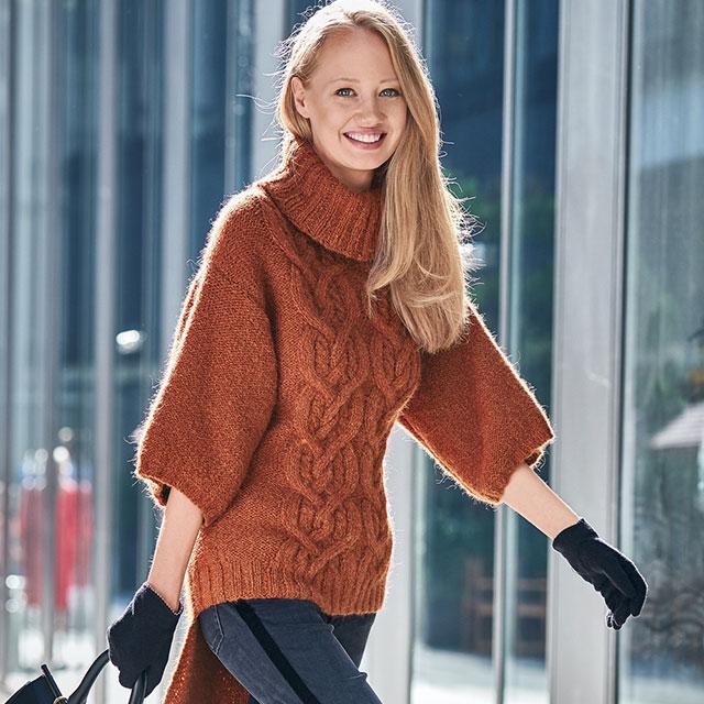 Женский свитер с укороченными рукавами и удлиненной спинкой